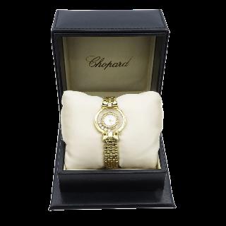 """Montre Boucheron """"Reflet"""" de Dame Petit modèle à quartz en or et acier de 2004."""