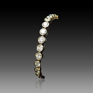 """Montre Boucheron """"Reflet"""" en or jaune 18k et acier de Dame petit modèle à quartz ."""