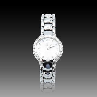 """Montre Cartier médium """"Panthère"""" Or 18k  3 rangs et acier quartz Vers 1995."""