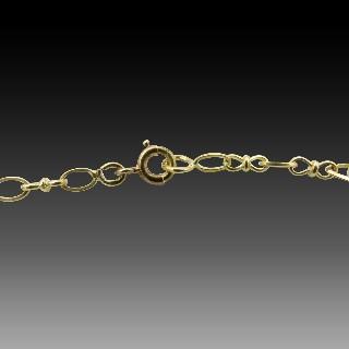 Sautoir en or jaune 18k vers 1900 de 150 cm.  Poids : 34,40 grs