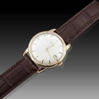 Montre Omega  Or rose 18k de 1960. 33 mm. Automatique. ref : 14703-1