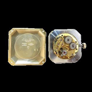 Montre Baume & Mercier Vintage Rectangulaire  Or jaune 18k mécanique Vers 1970.