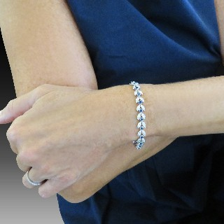 Bracelet articulé en or gris 18 Cts avec Diamants et Saphirs