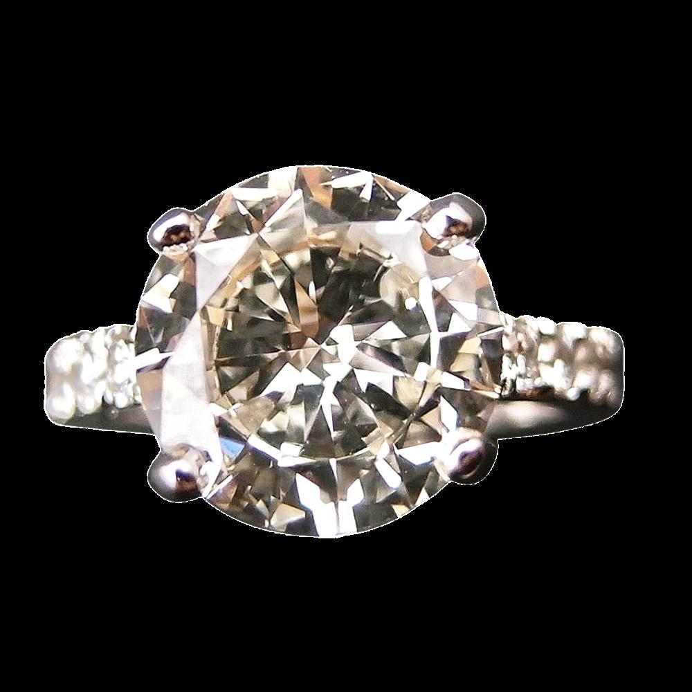 Solitaire en or gris 18k avec Diamant brillant 3.04 Cts M-VS1 + 0.30Cts.