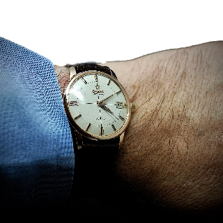 Montre Omega Vintage ref: 14703 Automatique en Or rose 18k  Vers 1960. 33 mm.