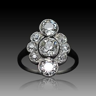 Bague entourage vers 1920 en platine avec 2.0 Ct  de Diamants taille ancienne .Taille 56