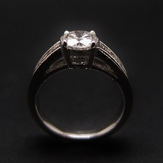 Solitaire Diamant brillant 1.07 Cts E-VS2 en Or 18 Cts + 0.36 Cts.