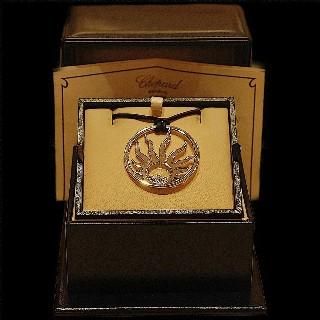 "Pendentif Chopard ""Happy Diamonds"" Or gris 18k Diamants de 2006."