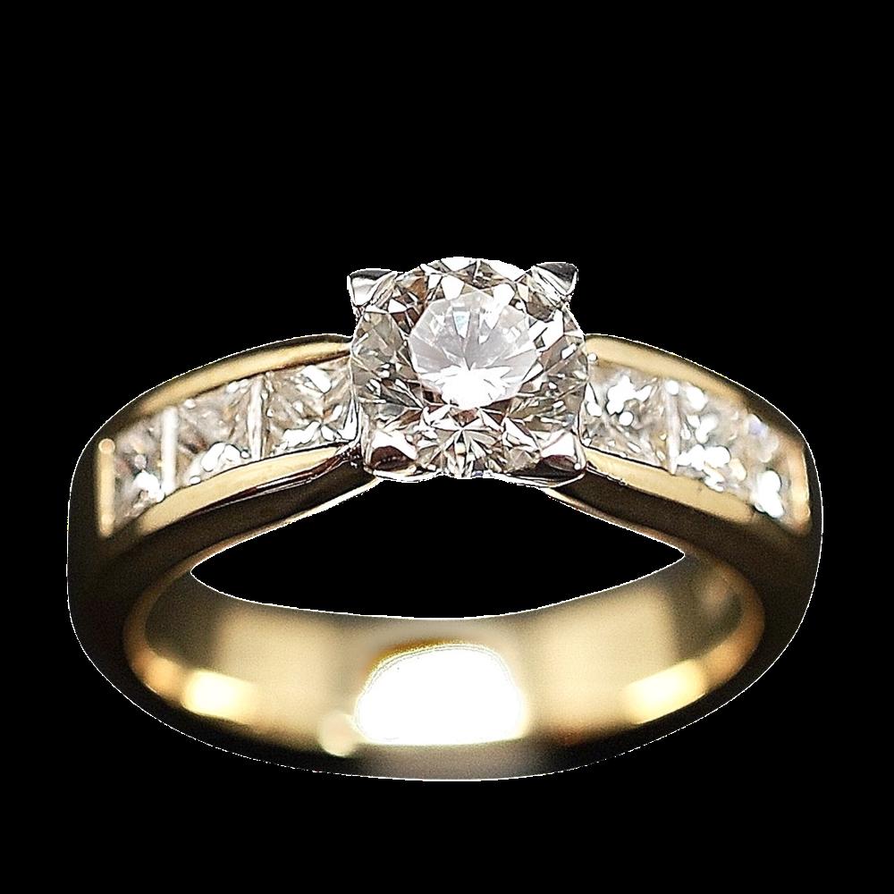 Solitaire Diamant de 1.01 Cts I-SI1 + 1.20 Cts sur côtés en Or jaune 18 Cts .