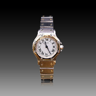 """Montre Cartier dame """"Santos"""" Octogonale en or et acier Automatique Vers 1985."""