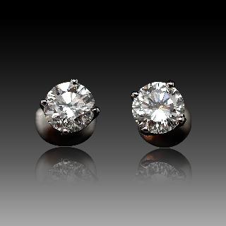 Puces d'oreilles Or gris 18k avec Diamants brillants 1.04 Cts et 1.01 Cts. E-VS2