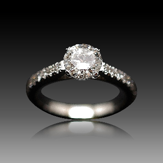 Solitaire Diamant 1.04 Cts G-VS2 en Or 18 Cts + 0.35 Cts.