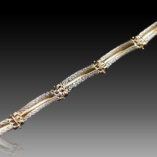 Bracelet or jaune 18k et acier .
